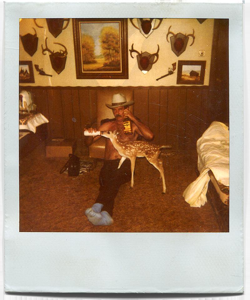 """The """"Marlboro Man"""" bottle-feeding a fawn while drinking Jose Cuervo."""