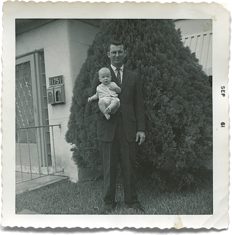 My father holding Danny, 1961